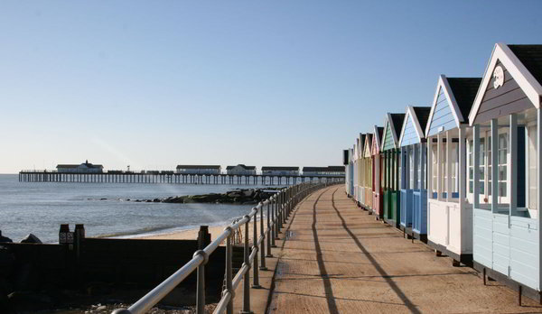 The iconic beach huts with Southwold Pier in the background